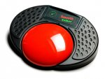 Bright, red, and round button mounted on a low-profile, oval, and black base.