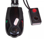 Two black components with cords attached. One is larger and more oval-shaped; the second is small and rectangular, with a red button.