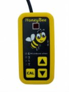 Vertical rectangular device with a yellow border and black face that has a cartoon bee image on the top half and control buttons on the lower half.