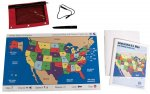Large printout of United States, with states in different colors, a red plastic pouch on the upper left and a booklet with a map of the U.S. on the right.