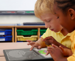 Two children touching a tablet that has a white-on-black outlined picture of a head and brain. Below is a color rendition of the same pic.