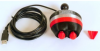 Black, oval-shaped device with two red buttons on one end and a cable coming out of the other end with a USB connector.