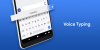 """Voice typing screen where the word """"listening"""" appears above the on-screen keyboard."""