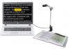 A computer with a desktop mono-pole type standing camera that has a book below its lens. On the computer screen, the words are written with one of them highlighted in yellow and written with red letters.