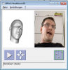 screen with A 3D head imitating the gesture of man's head next to the actual image of a mans head